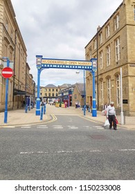 HUDDERSFIELD, UK - AUGUST 1, 2018: Street sign marking the entrance to the Huddersfield Indoor Market in the centre of Huddersfield, West Yorkshire, UK