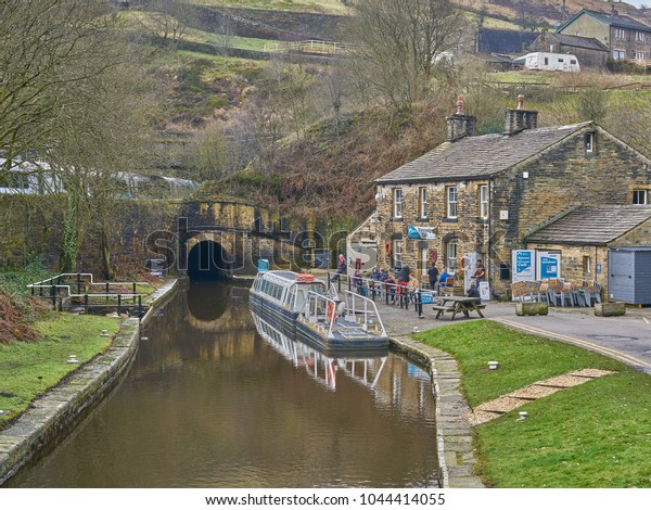 Huddersfield, West Yorkshire, England - March 11 2018: Historic canal tunnel at Standedge near Marsden, the highest, longest and deepest in the UK. The train pictured, runs through an adjacent tunnel.