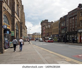 huddersfield, west yorkshire, United Kingdom - 20 May 2019: traffic and pedestrians on westgate road in the centre of huddersfield west yorkshire
