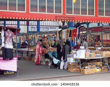 huddersfield, yest yorkshire, United Kingdom - 20 May 2019: women shopping for fabric and sewing materials on a stall in huddersfield market in west yorkshire