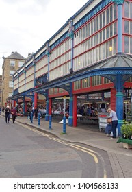 huddersfield, yest yorkshire, United Kingdom - 20 May 2019:people walking and shopping in huddersfield market in west yorkshire