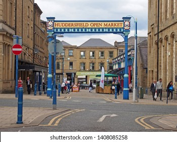 huddersfield, yest yorkshire, United Kingdom - 20 May 2019: the metal outdoor gate of huddersfield open market area and building in byram street with shops stalls and pedestrians