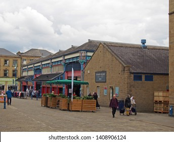 huddersfield, yest yorkshire, United Kingdom - 20 May 2019: people walking and shopping in huddersfield open market in west yorkshire