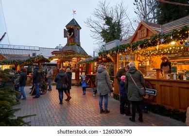 Hude, Germany - December 16, 2018: wooden huts at the traditional Christmas market in late afternoon