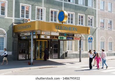 Hudiksvall, Halsingland, Gavleborg County /Sweden - 08 01 2019: Family with children walking to te entrance of a shopping mall