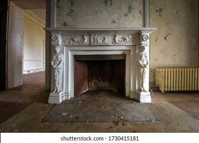 Hudson, NY / USA - 04/14/2020 - Fire place with beautiful details in Abandoned Mansion
