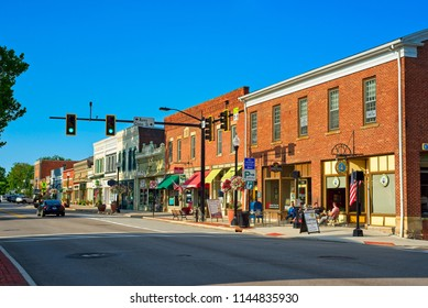 HUDSON, OH - JULY 28, 2018: Main St. cafes, shops, and businesses come to life on a Saturday morning in this charming northeast Ohio village.