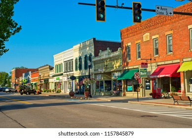 HUDSON, OH - JULY 28, 2018: A view along North Main Street with shops, cafes, and businesses as the charming small town comes to life on a sunny Saturday morning in tnortheast Ohio.