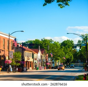 HUDSON, OH - JUNE 14, 2014: Main Street in Hudson is lined with quaint shops and businesses that go back more than a century, giving the NE Ohio village a unique charm.
