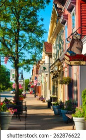 HUDSON, OH - JUNE 14, 2014: Quaint shops and businesses, anchored by the popular Learned Owl bookstore at right, go back more than a century give Hudson's Main Street a charming and inviting appeal.