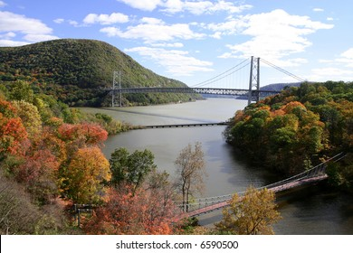 Hudson River looking south, the Bear Mountain Bridge, Anthony's Nose, and a foot bridge in the foreground.