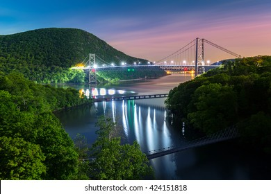 Hudson River valley with Bear Mountain bridge illuminated by night, in New York state