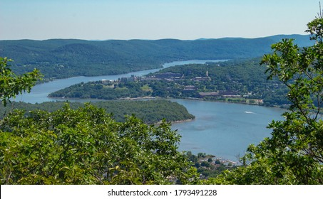Hudson River Winding Though Mountain Range Near a Small Town