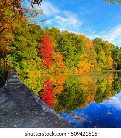 Hudson Valley NY fall season with lake reflection of the red, orange and yellow leaves.