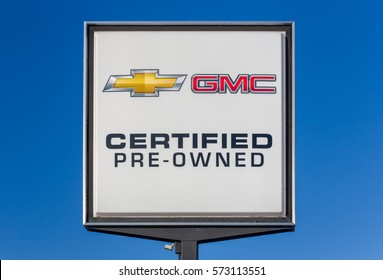 HUDSON, WI/USA - FEBRUARY 5, 2017: Chevrolet and GMC pre-owned automobile dealership sign.  Chevrolet and GMC are American automobile divisions of the American manufacturer General Motors.