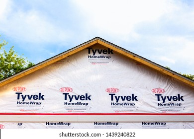 HUDSON, WI/USA - JUNE 18, 2019: Tyvek residential exterior wrapping and trademark logo.