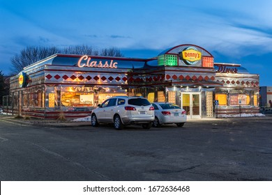 HUDSON, WI/USA - MARCH 8, 2020: Denny's Classic Diner restaurant at twighlight and trademark logo.