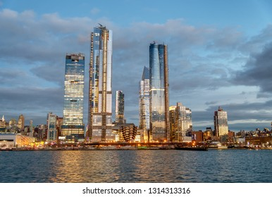 Hudson Yards Midtown Manhattan skyscrapers as seen from cruise ship at dusk.