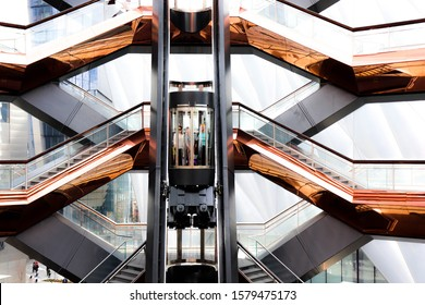 Hudson Yards, New York, NY 10001, USA April 8 2019 The Vessel is a new architecture structure with the staircases leading  to each direction and one elevator that some use. Very interesting design.