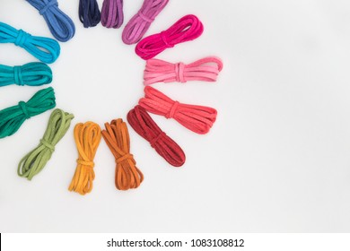 hue circle (color harmony) of various strings on white background. color wheel of colorful threads. bundle of chamois string. Rainbow and Colorful circle pattern.