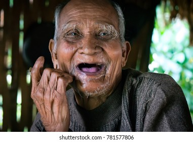 HUE, VIET NAM, December 19, 2017 old man's face, ethnic Co Tu (anonymous) in the Central Highlands of Hue, Vietnam, friendly smile