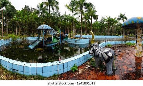 Hue / Vietnam - 04 22 2017: desolated swimming pool in abandoned water park Ho Thuy Then, close to Hue city, off beaten path tourist attraction in Central Vietnam, Southeast Asia