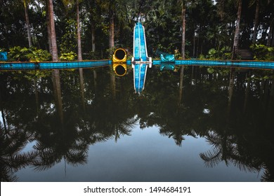 Hue, Vietnam - 18.4.2018: Desolated water slides in an abandoned water amusement park Ho Thuy Tien located in the outskirts of Hue, Central Vietnam