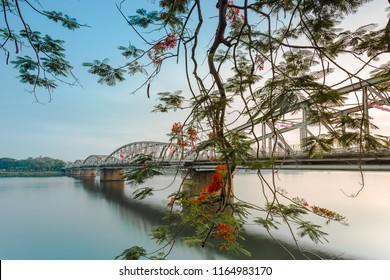 HUE, VIETNAM, 22 MAY, 2018: Truong Tien Bridge, cross Huong river, an old bridge link with history, Trang Tien brigde reflect on water, way to the citadel of Hue. A UNESCO World Heritage Site