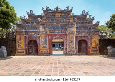 """HUE, VIETNAM, 22 MAY, 2018:Old Gate entry to Dien Tho Palace inside the citadel of Hue. A UNESCO World Heritage Site. Translation:""""Signboard of Dien Tho Palace"""""""