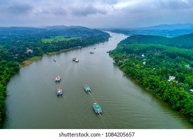 HUE, VIETNAM - APRIL 18,2018: Aerial view of festival Hon Chen temple on Huong river, Hue, Vietnam. Hon Chen festival takes place in March and July lunar calendar.