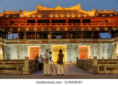 Hue, Vietnam - April 5, 2018: Amazing evening view of the Meridian Gate to the Imperial City with the Purple Forbidden City within the Citadel. The Citadel is a popular tourist attraction of Asia.