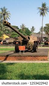 HUE - VIETNAM - APRIL 7, 2016 : Vietnam war era decommissioned Soviet Union 122 mm. howitzer artillery displayed at HUE war museum in vertical.