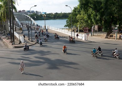 HUE, VIETNAM - August 16, 2014. Mopeds, cycles and people cross at the busy junction of the Trang Tien Bridge.