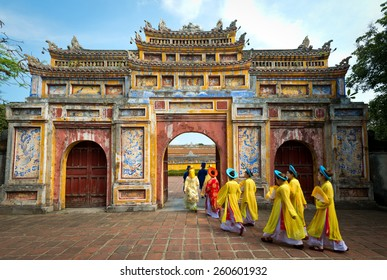 HUE, VIETNAM - May 1, 2014 : People in traditional costumes walk under an archway in the Imperial City of Hue, Vietnam.