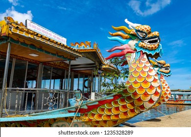 HUE, VIETNAM - NOVEMBER 19, 2018: Traditional Dragon Boat on the Perfume River in Hue, Vietnam. Popular tourist attraction.