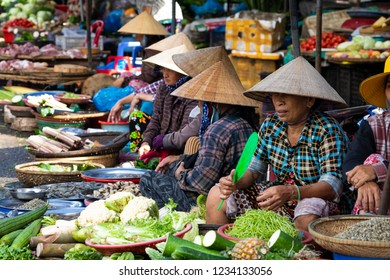 HUE, VIETNAM - NOVEMBER 19,2018: Sellers on the local market in Vietnam. Traditional food market in Hue, Vientam.