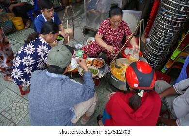 HUE - VIETNAM - November 6,2016; Street vendor sale local food for Vietnamese in street market in Hue , Vietnam