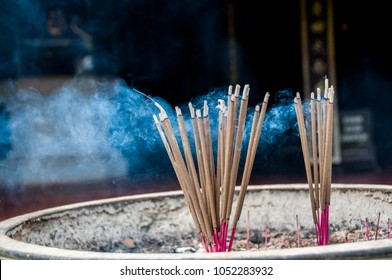 Hue, Vietnam - oct 2013 : sticks of incense burned in a brazier at the entrance of the Thien Mu pagoda near Hue in Vietnam