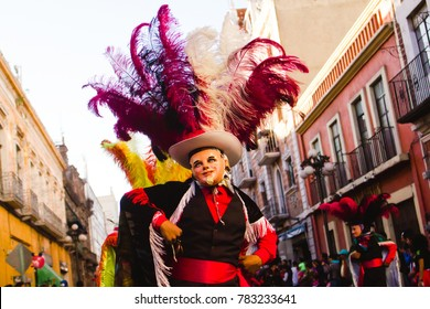 Huehues Mexico, Carnival scene, dancer wearing a traditional mexican folk costume and mask rich in color