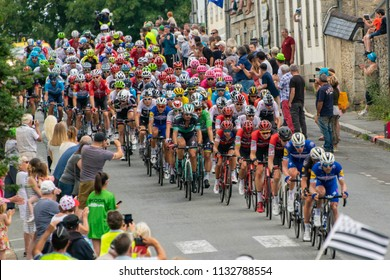 Huelgoat, Brittany, France, July 12th 2018: Tour de France contestants passing through the village of Huelgoat cheered on by the local people gathered in the main street