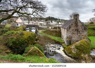 The Huelgoat, a small town in Brittany, in the heart of the Regional Natural Park of Armorique. An old mill is located at the foot of the lake dam.