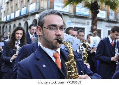 HUELVA, ANDALUSIA, SPAIN - APRIL 1: Music band the penitents of the brotherhood  in typical procession Holy Week on Palm Sunday in April 1, 2012 in  in Huelva, Andalusia, Spain