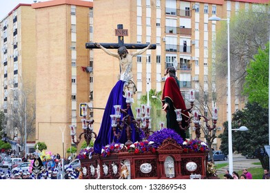HUELVA, ANDALUSIA, SPAIN - MARCH 25: The penitents of the brotherhood accompanied Christ on Easter Monday (el Perdon) tradition hundreds of years, typical in Andalusia, march 25, 2013 in Huelva, Spain