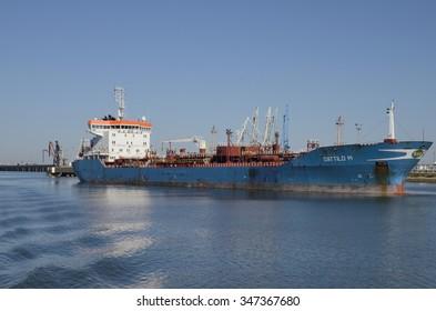 HUELVA, SPAIN - DECEMBER 3: Cargo ship on Odiel river at the Port of Huelva, Andalusia, Spain on December 3, 2015.