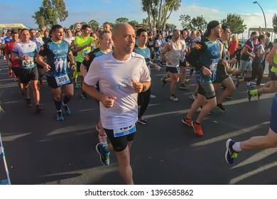 Huelva, Spain - May 4, 2019:  Runners at the start of the Huelva solidary 10K Run on May 2019. The first 10K race held in Huelva