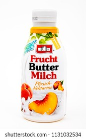 HUETTENBERG, GERMANY- JUNE 07, 2018: Plastic bottle of Mueller peaches and nectarines drink on white background