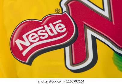 HUETTENBERG, GERMANY- JUNE 7, 2018: NESTLE Logo of Bar of NUTS Chocolate in Detail.