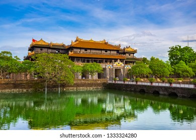 HUE-VIETNAM PHOTO TRIP-Jul. 2017  Tourists take a photo in front of the palace entrance.Hue royal Palace it was built in 1804. Now is registered as a UNESCO World Heritage Site. - Image