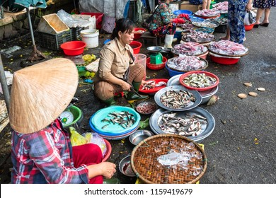 HUE,VIETNAM-JULY 20,2018 : Traditional Vietnamese fish market.There are also some Vietnamese people wearing a non la vietnam hat