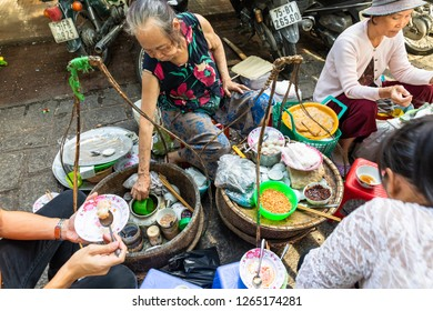 HUE,VIETNAM-JULY 20,2018 : Traditional Vietnamese food Sold on the street footpath. There are tables and small chairs.